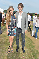 HUM FLEMING and TARA FERRY at the Laureus Polo held at Ham Polo Club, Ham, Richmond, Surrey on 18th June 2015.