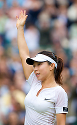 LONDON, ENGLAND - Friday, June 27, 2008: Jie Zheng (CHN) waves to the court after her 3rd round victory on day five of the Wimbledon Lawn Tennis Championships at the All England Lawn Tennis and Croquet Club. (Photo by David Rawcliffe/Propaganda)