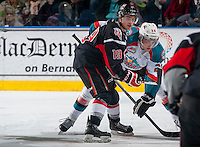 KELOWNA, CANADA - FEBRUARY 14: Brayden Point #19 of Moose Jaw Warriors faces off against Leon Draisaitl #29 of Kelowna Rockets on February 14, 2015 at Prospera Place in Kelowna, British Columbia, Canada.  (Photo by Marissa Baecker/Shoot the Breeze)  *** Local Caption *** Leon Draisaitl; Brayden Point;