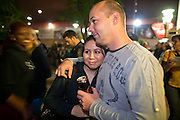 "24 NOVEMBER 2011 - PHOENIX, AZ Tracie Lugo (CQ) and her husband, Dustin Poole (CQ) cuddle while they wait for the mall to open at Paradise Valley Mall Thursday. ""Black Friday,"" the unofficial start of the holiday shopping season started even earlier than normal. Many stores, including Target and Best Buy, opened at midnight.    Photo by Jack Kurtz"