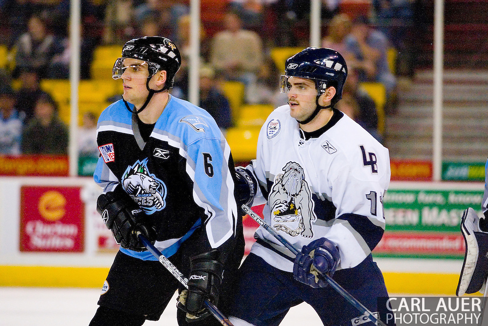 19 February, 2006 - Anchorage, AK:  Kevin Ulanski (11) sets up between the goal and Aces Patrick Wellar (6) as the Alaska Aces take a overtime victory, 3-2 against the visiting Long Beach IceDogs at the Sullivan Arena.