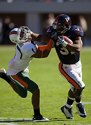 Virginia running back Cedric Peerman (37) delivers a punishing stiff arm to Miami (FL) defensive back Brandon Harris (1).  The Virginia Cavaliers faced the Miami Hurricanes in a NCAA football game at Scott Stadium on the Grounds of the University of Virginia in Charlottesville, VA on November 1, 2008.Miami defeated Virginia 24-17 in overtime.
