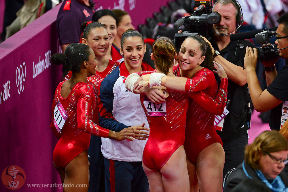 Jul 31, 2012; London, United Kingdom; McKayla Maroney (USA), 412, is hugged by Jordyn Wieber (USA), far right, as Gabrielle Douglas (USA), 411, Kyla Ross (USA), second from left, and Alexandra Raisman (USA), center, look on after Maroney competed on the vault in the women's team gymnastics finals during the London 2012 Olympic Games at North Greenwich Arena.