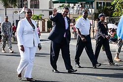 Governor John P. de Jongh waves to member of the crowd.  Veteran's Day Parade and Program at the Frankliin Delano Roosevelt Memorial Park in Charlotte Amalie.  St. Thomas.  11 November 2013.  © Aisha-Zakiya Boyd
