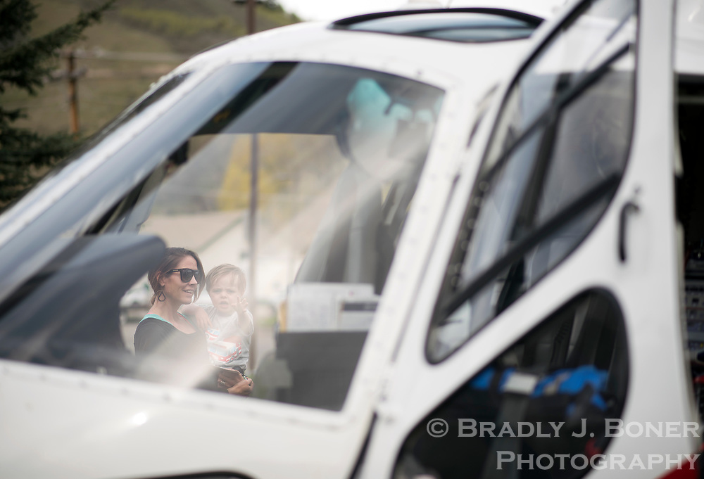 Chelsea Robinson and her son, Dash, 2, check out the Air Idaho helicopter during the St. John's Community Health Fair on Saturday at the Jackson/Teton County Recreation Center.