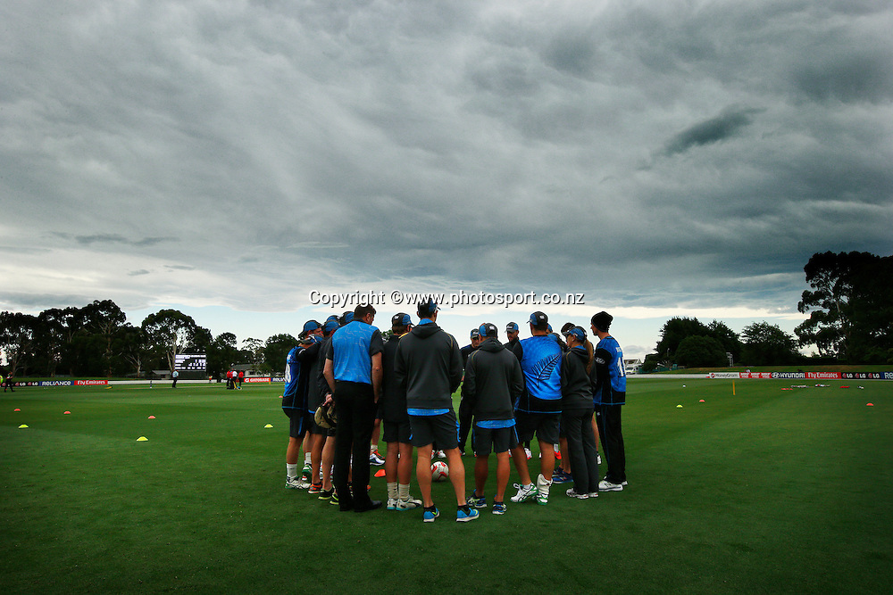 Black Caps team huddle before the ICC Cricket World Cup warm up game between the Black Caps v Zimbabwe at Bert Sutcjliffe Oval, Lincoln, Christchurch. 9 February 2015 Photo: Joseph Johnson / www.photosport.co.nz
