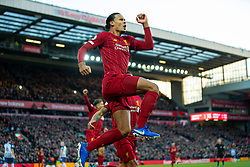 LIVERPOOL, ENGLAND - Saturday, November 30, 2019: Liverpool's Virgil van Dijk jumps as he celebrates scoring the first goal during the FA Premier League match between Liverpool FC and Brighton & Hove Albion FC at Anfield. Van Dijk scored both goals as Liverpool won 2-1. (Pic by David Rawcliffe/Propaganda)