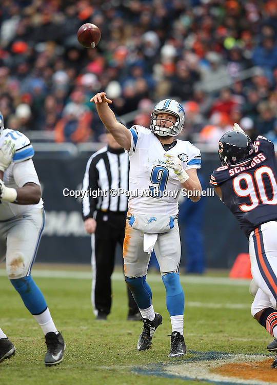 Detroit Lions quarterback Matthew Stafford (9) throws a third quarter pass while pressured by Chicago Bears defensive lineman Greg Scruggs (90) during the NFL week 17 regular season football game against the Chicago Bears on Sunday, Jan. 3, 2016 in Chicago. The Lions won the game 24-20. (©Paul Anthony Spinelli)
