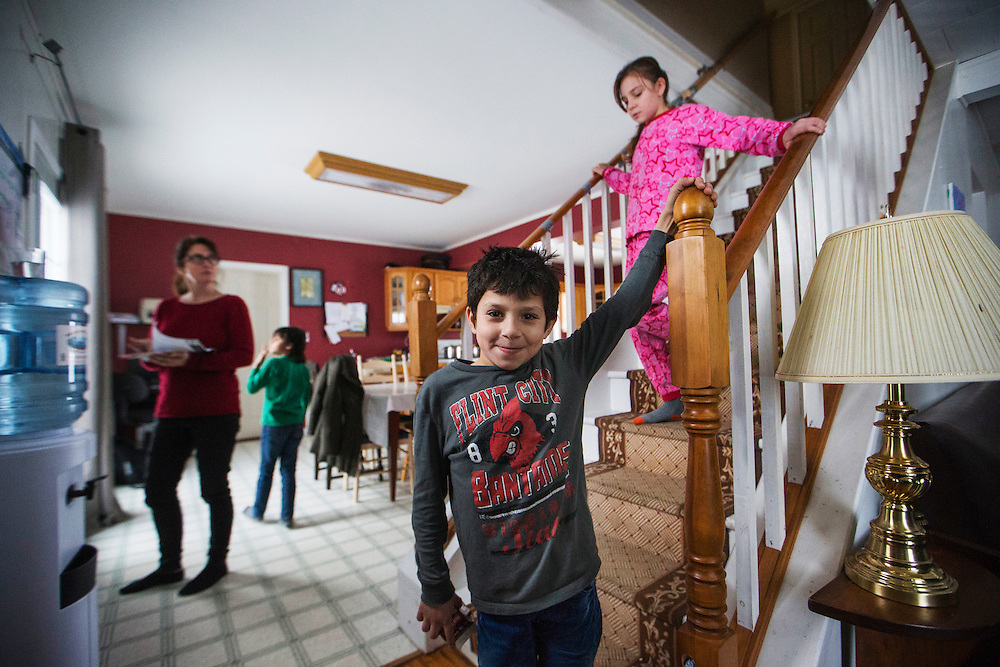 Syrian refugee Madjid Al Jasem stands at the bottom of the stairs inside their temporary home in Picton, Ontario, Canada, Wednesday January 20, 2016.   (Mark Blinch for the BBC)