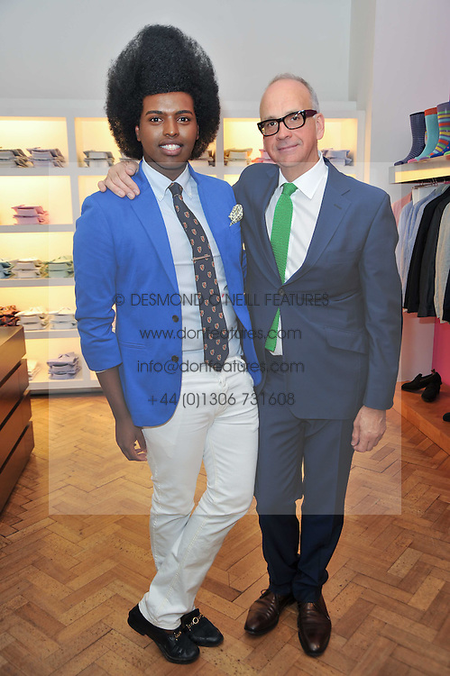 Left to right, RICHARD JAMES and PRINCE CASSIUS at a party to launch a range of SpongeBob SquarePants suits and accessories designed by Richard James in partnership with Nickelodeon held at Richard James, 29 Savile Row, London W1 on 11th May 2011.