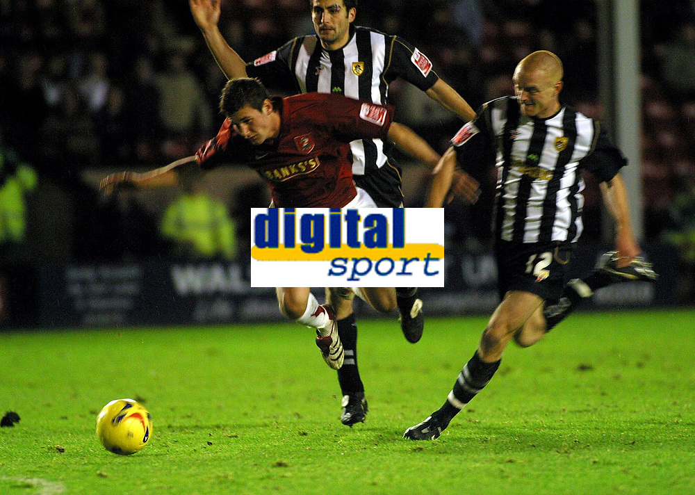 Photo: Dave Linney.<br />Walsall v Notts County. Coca Cola League 2. 25/11/2006.<br />Walsall's Tommy Wright(L) is sent flying by  Gary Silk.