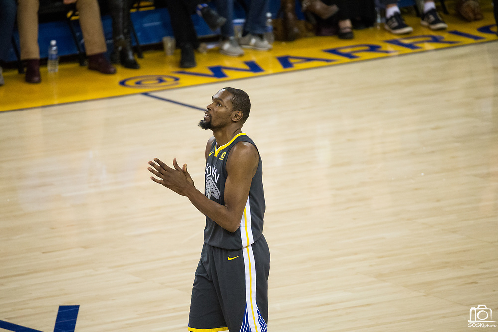 Golden State Warriors forward Kevin Durant (35) reacts to a foul called on him against the LA Clippers at Oracle Arena in Oakland, California, on February 22, 2018. (Stan Olszewski/Special to S.F. Examiner)