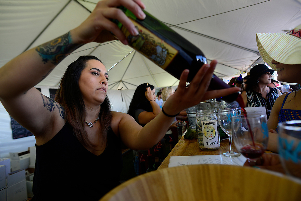apl052817a/ASECTION/pierre-louis/JOURNAL 052817<br /> Angelica Garcia,, pours a glass of Blanco Rojo from the Wines of  the San Juan Winery during the Albuquerque Wine Festival held at the Balloon Fiesta Park .Photographed  on Sunday May 28,  2017. .Adolphe Pierre-Louis/JOURNAL
