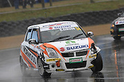 The Suzuki Swift of Taupo's Rob Gibson shows damage during the second race for the Suzuki Swift Sport Cup at the CRC 200 at Timaru International Motor Raceway on 22 January 2012. The CRC 200 is part of the New Zealand Premier Race Championship Series.