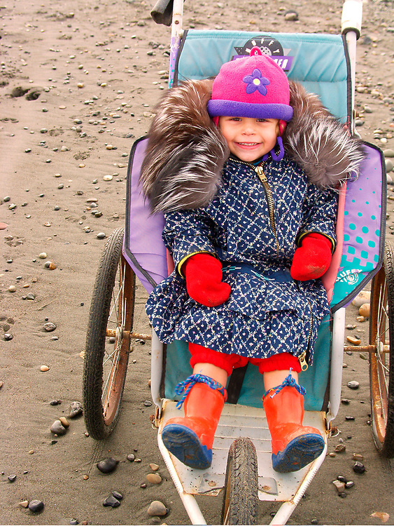 Barrow, Alaska. Juliana Aikins on a bicicle stroller at the beach. MR