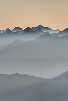 Overlaying ridges of jagged peaks in the North Cascades silhouetted at dawn. Mount Baker Wildernerss Washington USA