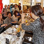 NLD/Den Bosch/20120214 - Valentijnslunch 2012 Addy van den Krommenacker, Sandra Reemer neemt foto's