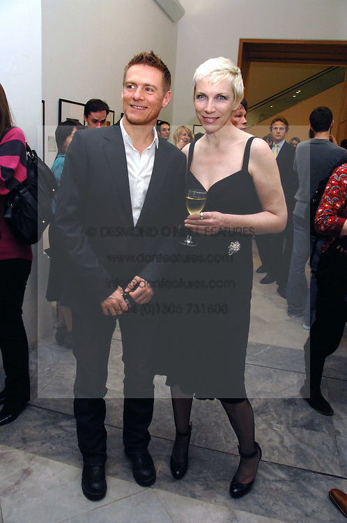 BRYAN ADAMS and singer ANNIE LENNOX at a private view of Bryan Adam's photographs entitled 'Modern Muses' held at The National Portrait Gallery, London on 11th March 2008.<br /><br />NON EXCLUSIVE - WORLD RIGHTS