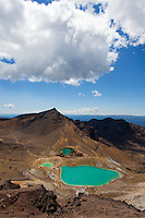 The Emerald Lakes shine bright below the steam spouting from the volanoes of Tongariro.