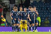 GOAL! - Scotland celebrate their 3rd goal as Gafurzhan Suyumbaev (#16) of Kazakhstan falls to his knees during the UEFA European 2020 Qualifier match between Scotland and Kazakhstan at Hampden Park, Glasgow, United Kingdom on 19 November 2019.