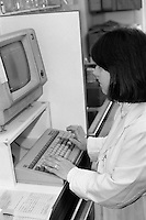 Pharmacist at computer terminal, Nether Edge Hospital, Sheffield.