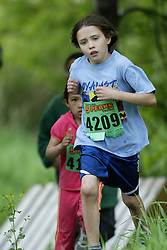 "(Kingston, Ontario---16/05/09) ""Brogan Macdougall running in the kids race at the 2009 Salomon 5 Peaks Trail Running series Race held in Kingston, Ontario as part of the Eastern Ontario/Quebec division. ""  Copyright photograph Sean Burges / Mundo Sport Images, 2009. www.mundosportimages.com / www.msievents.com."