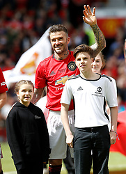 Manchester United Legends player David Beckham lines up with children Cruz and Harper, before the legends match at Old Trafford, Manchester.