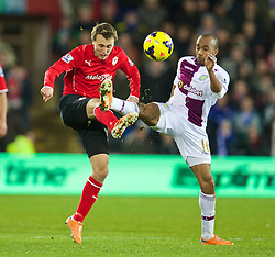 CARDIFF, WALES - Tuesday, February 11, 2014: Cardiff City's Magnus Wolff Eikrem in action against Aston Villa's Fabian Delph during the Premiership match at the Cardiff City Stadium. (Pic by David Rawcliffe/Propaganda)