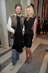 NOELLE RENO and SCOTT YOUNG at a party to launch the Georgina Chapman collection for Garrard held at Garrard, Albermarle Street, London on 4th November 2009.