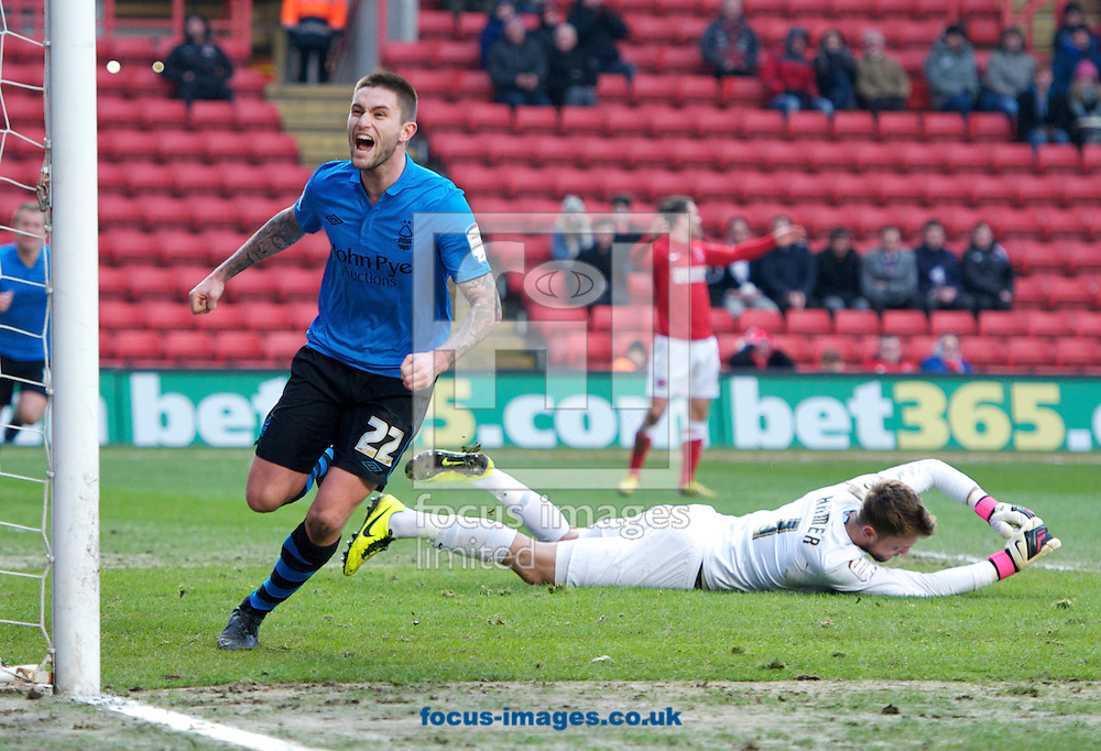 Picture by Alan Stanford/Focus Images Ltd +44 7915 056117.23/02/2013.Henri Lansbury of Nottingham Forest scores the second goal during the npower Championship match at The Valley, London.