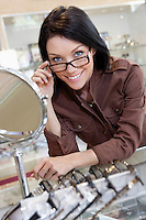 Portrait of a happy beautiful mid adult woman wearing glasses