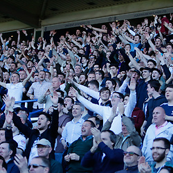 Derby fans celebrate after the final whistle