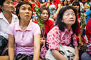 03 MARCH 2013 - BANGKOK, THAILAND: <br />  Pheu Thai members and supporters of Pongsapat Pongchareon glumly watch as election results in the Bangkok governor's race come into the Pheu Thai headquarters. Pongsapat Pongchareon, running on the Pheu Thai ticket, lost the Bangkok's Governor's race to MR Sukhumbhand Paribatra, the incumbent running on the Democrat ticket. Sukhumbhand won the race after scoring a record number of votes, more than 1.2 million to Pongsapat's 1 million. The results were seen as an upset even though Sukhumbhand was the incumbent because all of the pre-election polls and the exit polls conducted on election day showed Patsapong winning.    PHOTO BY JACK KURTZ