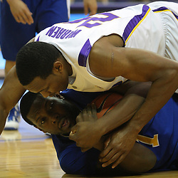 Jan 04, 2010; Baton Rouge, LA, USA;  LSU Tigers forward Storm Warren (24) falls on McNeese State Cowboys forward Will Morning (1) during the first half at the Pete Maravich Assembly Center.  Mandatory Credit: Derick E. Hingle-US PRESSWIRE
