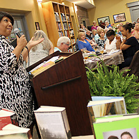 Tupelo poet Patricia Neely-Dorsey shares some of her works with the audience gathered at a fundraiser Saturday for Nettleton's Dorothy J. Lowe Library.