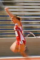 Female track athlete crossing finishing line