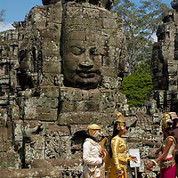 Cambodian with traditional clothes at Angkor temple