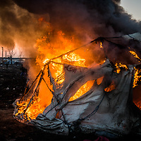 Calais 10-03-2016 Refugee camp in Calais, called the jungle. Begin clearing operations of the refugee camp; Refugees burn their huts to protest against the clearing