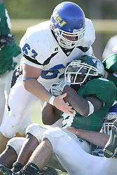 15 September 2007:  Assisted by Travis Blank, Marcus Dunlop lands on his tackler. The Titans stood toe to toe with the 25th ranked Lions through the first half but ended the game on the losing end of a 25-15 score at Wilder Field on the campus of Illinois Wesleyan University in Bloomington Illinois.
