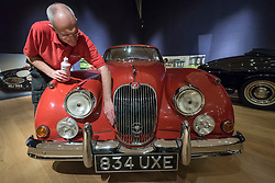 "© Licensed to London News Pictures. 29/11/2018. LONDON, UK. A technician polishes a 1959 Jaguar XK150 'S' 3.4-litre coupé (Est. GBP60,000-80,000). Preview of a sale of ""Fine Collectors' Motor Cars"" at Bonhams, New Bond Street.  30 vehicles will be offered for sale on 1 December.  Photo credit: Stephen Chung/LNP"
