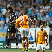 Dynamo Defender Andre Hainault #31 (middle) and Union Attacker Veljko Paunovic #16 (Left) try to make a play for the ball during Saturday MLS regular season match. The Dynamo and The Philadelphia Union played to a 1-1 tie. Saturday Aug. 6, 2011. at PPL Park in Chester PA...The News Journal/SAQUAN STIMPSON