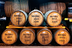 View of scotch whisky barrels in warehouse at Bowmore Distillery on island of Islay in Inner Hebrides of Scotland, UK