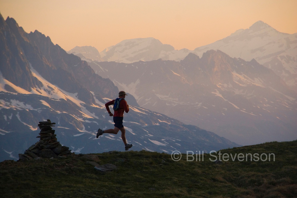 A picture of a a  man running at sunset in the French Alps near Chamonix France.