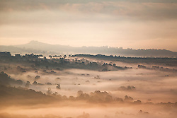 © Licensed to London News Pictures. 24/05/2016. Ilkley UK. Picture shows the fog covered town of Burley in Wharfedale at Dawn this morning seen from the top of Ilkley Moor in Yorkshire. Photo credit: Andrew McCaren/LNP