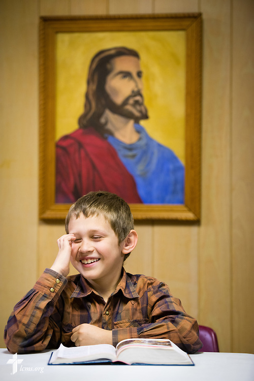 Corey Hanson reacts during a puppet show following worship on Sunday, April 12, 2015, at Mount Calvary Lutheran Church in Holdrege, Neb. LCMS Communications/Erik M. Lunsford