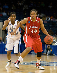 Georgia forward Tasha Humphrey (34) dribbles past North Carolina forward Jessica Breland (51).  The #1 seed North Carolina Tar Heels defeated the Georgia Bulldogs 80-66 in the second round of the 2008 NCAA Women's Basketball Championship at the Ted Constant Convocation Center in Norfolk, VA on March 25, 2008.