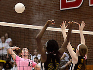 "6 Oct. 2011 -- ST. LOUIS. -- Bishop DuBourg High School volleyball player Jordan Quinilan (17) looks to spike the ball against Rosati-Kain High School's Oluwashayo Oginni (23) and Maggie Griffin (26) during a special ""pink game"" between the schools at DuBourg Thursday, Oct. 6, 2011. The ""pink game"" to benefitted SSM St. Mary's Health Care Center's Cancer Care, in honor of Rosati-Kain president Sister Joan Andert, SSND, who is currently undergoing treatment for breast cancer. Photo © copyright 2011 Sid Hastings."