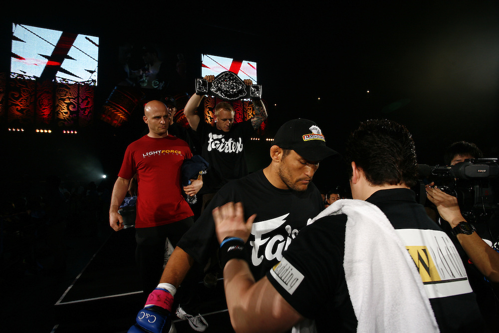 American  fighter   Dan  Henderson..BUSHIDO Extreme Martial Art fighting Rules are quite limited and fights usually carry on past the bloody nose stage.  It's  very popular in Japan, goes out on primetime TV, fighters get paid as much as 4 million US Dollars a fight and are seen as celebs. Crowd consist of young families, couples etc. Piece will look at why sport is so successful in Japan, appealing to so called 'lost generation' of young people suffering from effects of collapse of economy/rise of unemployment.