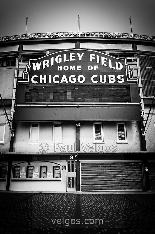 Wrigley Field Chicago Cubs sign in black and white. Wrigley Field is home of the Chicago Cubs and was built in 1914 making it one of the oldest baseball stadiums in the United States.