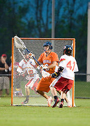 Virginia Goalie Bud Petit (8) makes a save in front of Maryland attackman Travis Reed (41).  The #3 ranked Virginia Cavaliers defeated the #8 ranked Maryland Terrapins 11-8 in the semi finals of the Men's 2008 Atlantic Coast Conference tournament at the University of Virginia's Klockner Stadium in Charlottesville, VA on April 25, 2008.